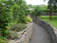 Stone walled path in Tallanstown park.