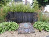 Water feature behind Tidy Towns plaque.