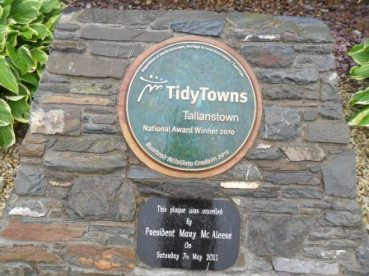 Tidy Towns National winners in 2010. They were presented the plaque by then president Mary McAleese.