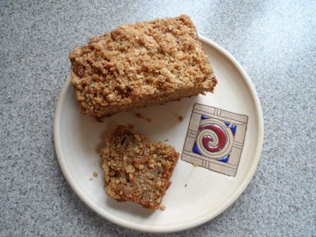 Zucchini bread with crumb topping on Vinegar Hill pottery.