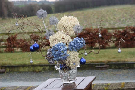 Annabelle hydrangea, blue hydrangea, allium, and twisted willow for Christmas.
