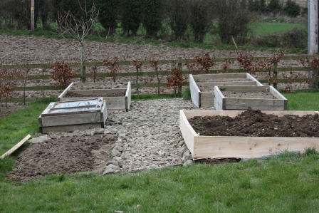 Adding a frame to the spud bed.
