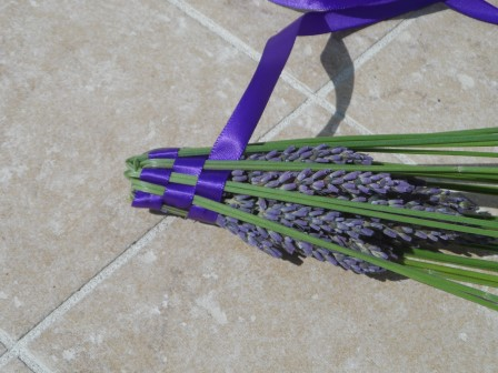 You weave the ribbon through the stems as you fold the stems over.