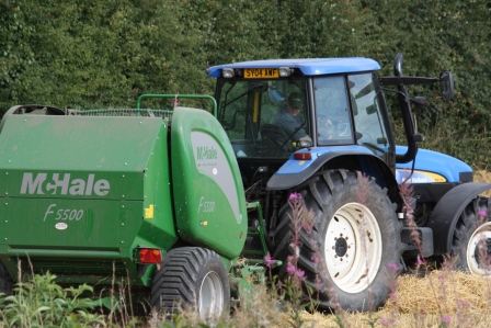 Tractor and baling machine.