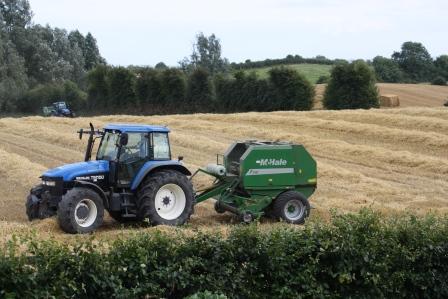 Tractor & baling machine.