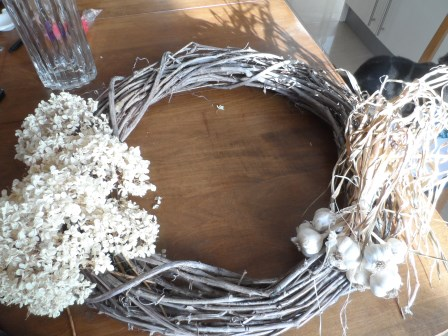 Adding garlic and Annabelle Hydrangea to wreath