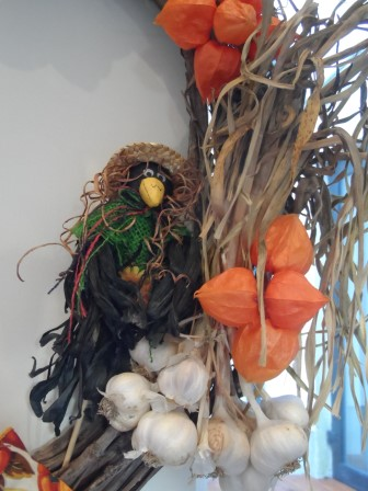 Chinese lantern, garlic, and a scare-crow on a wreath.