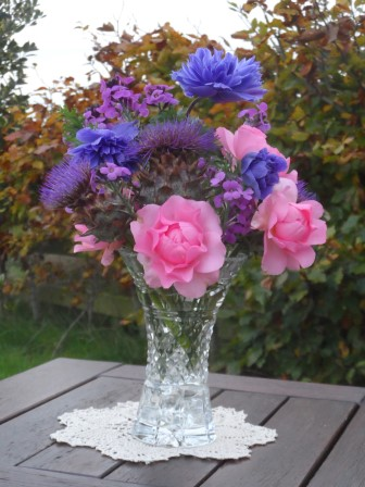 Artichokes, Mr. Fokker anemone, erysimum (bowles' mauve), and pink roses