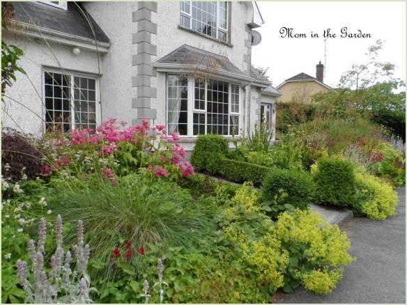 I especially love the boxwood lining the path/garden.