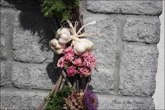 Garlic with dried roses and artichokes from the garden