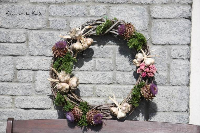 wreath made with garlic, dried artichokes and dried roses
