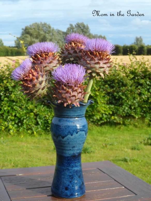 A vase full of artichokes