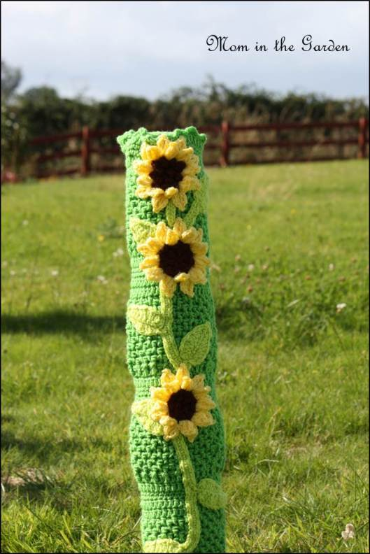 Yarn bombing the sewer pipe with sun flowers