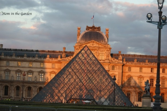 The Louvre glass pyramid entrance in evening light