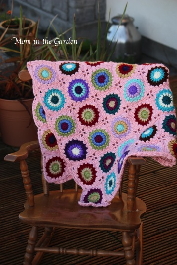 blanket on our kiddie rocking chair (before I put the border on it)