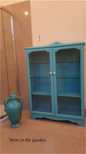 glass door cabinet painted turquoise