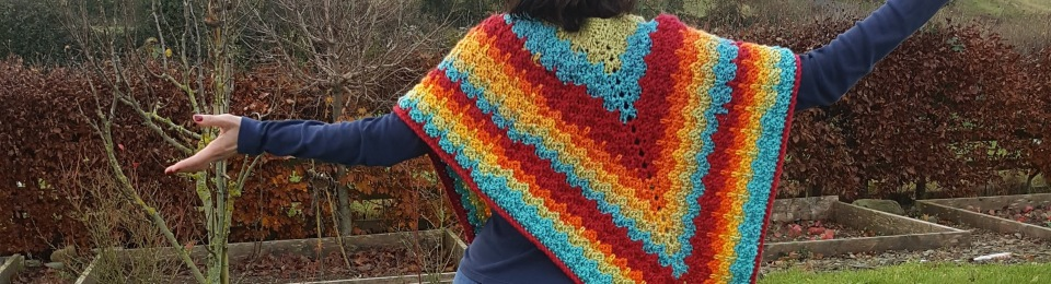 mom in the garden in finished poncho