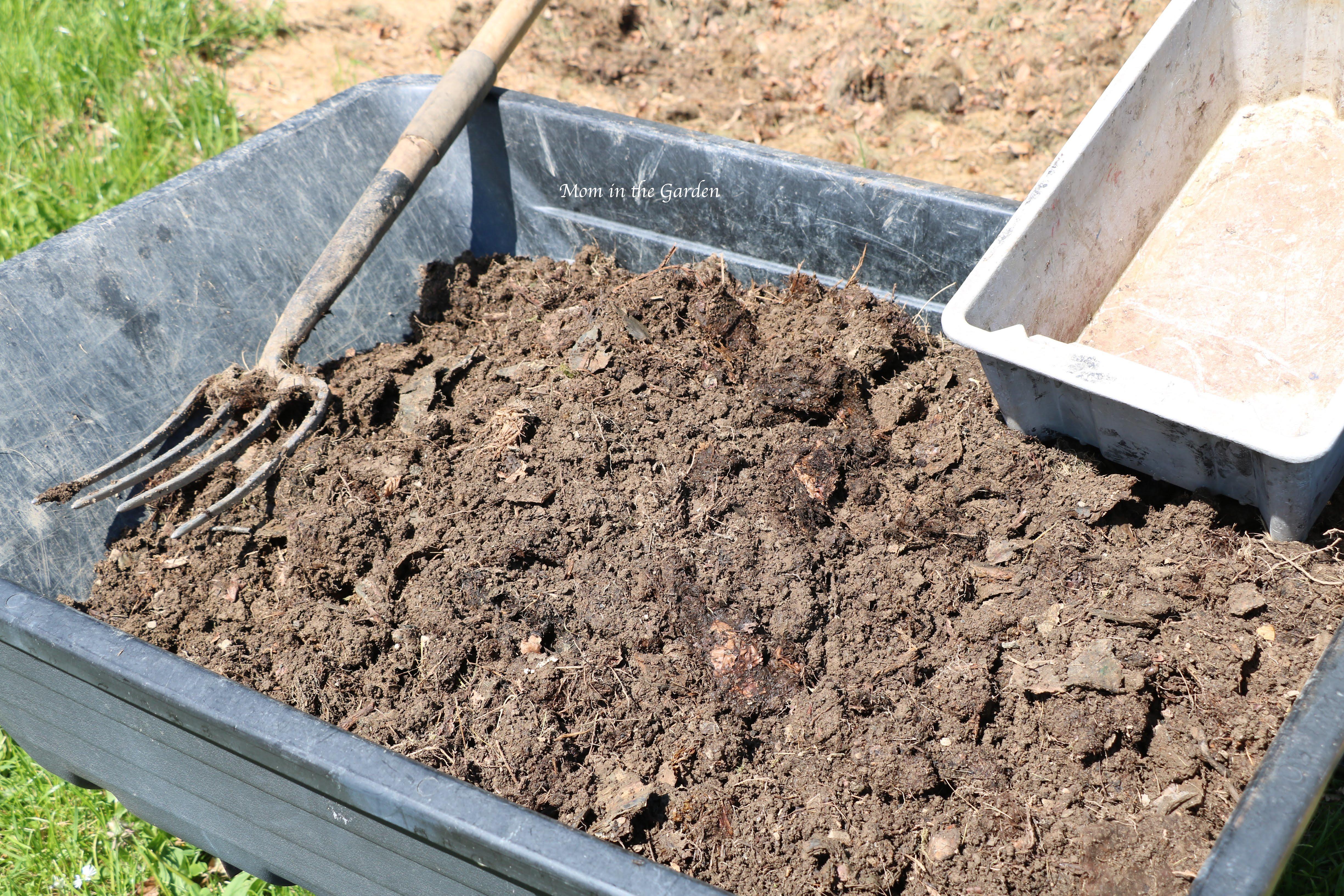 compost in a wheelbarrow