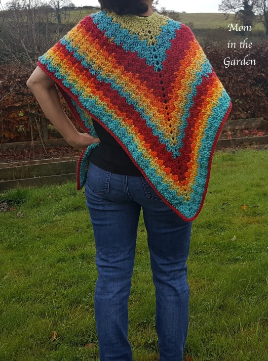 back view of completed rainbow poncho