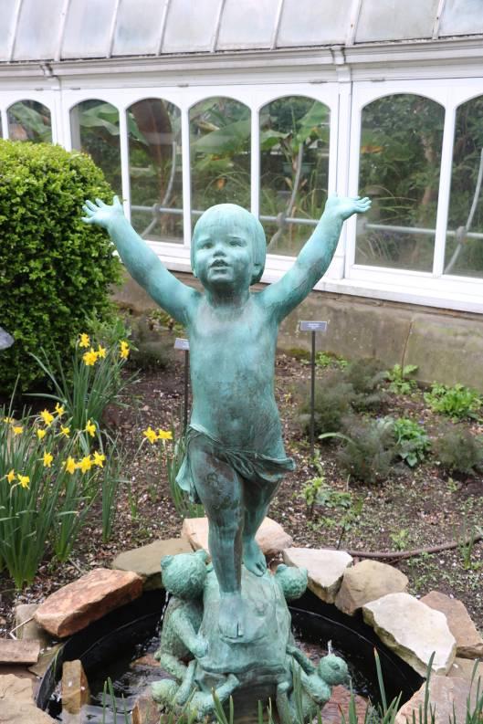child statue in garden