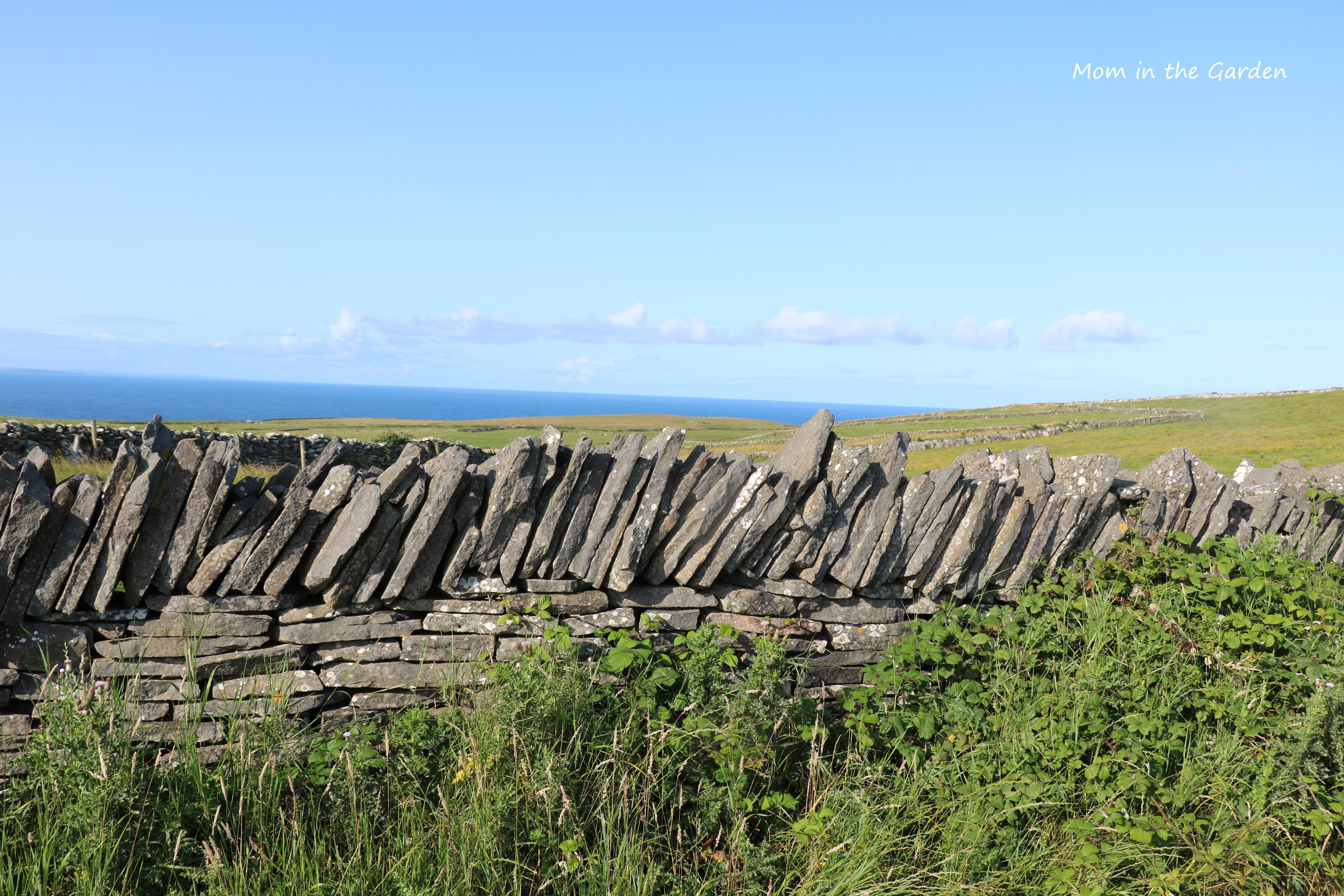 stone wall with view of sea