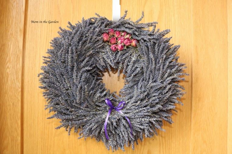 lavender wreath + roses on top + ribbon on door