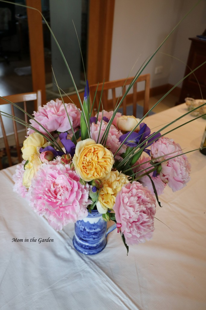 Vase of peony flowers roses and iris