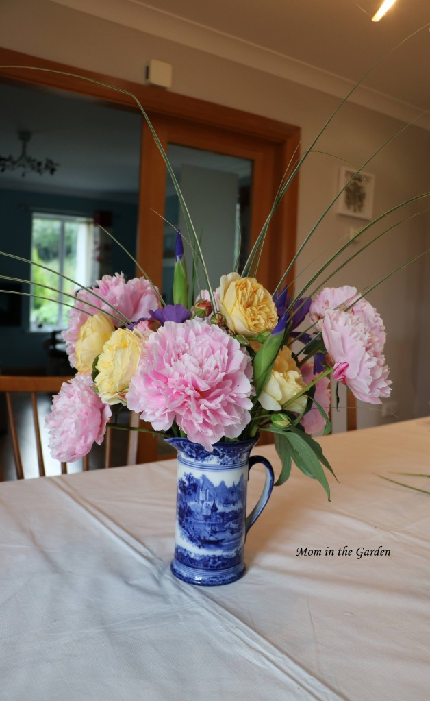 Vase of Peony flowers, roses and Dutch iris