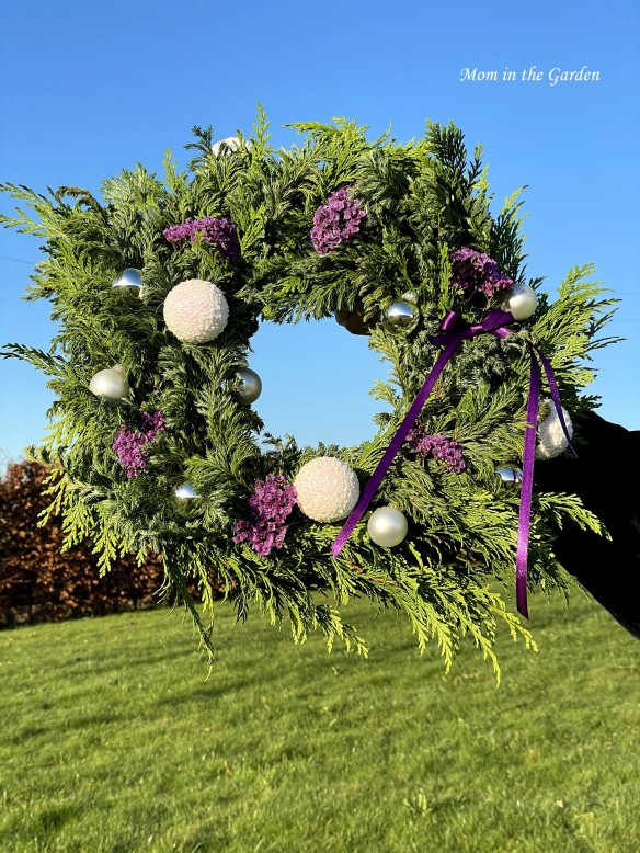 Hand made Christmas wreath with purple flowers