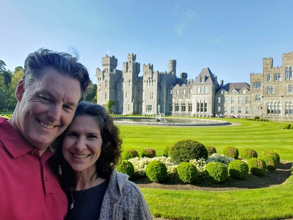 my husband and me in front of Ashford Castle