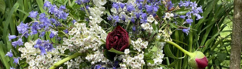 Peony Hawthorn bluebells up close floral arrangement