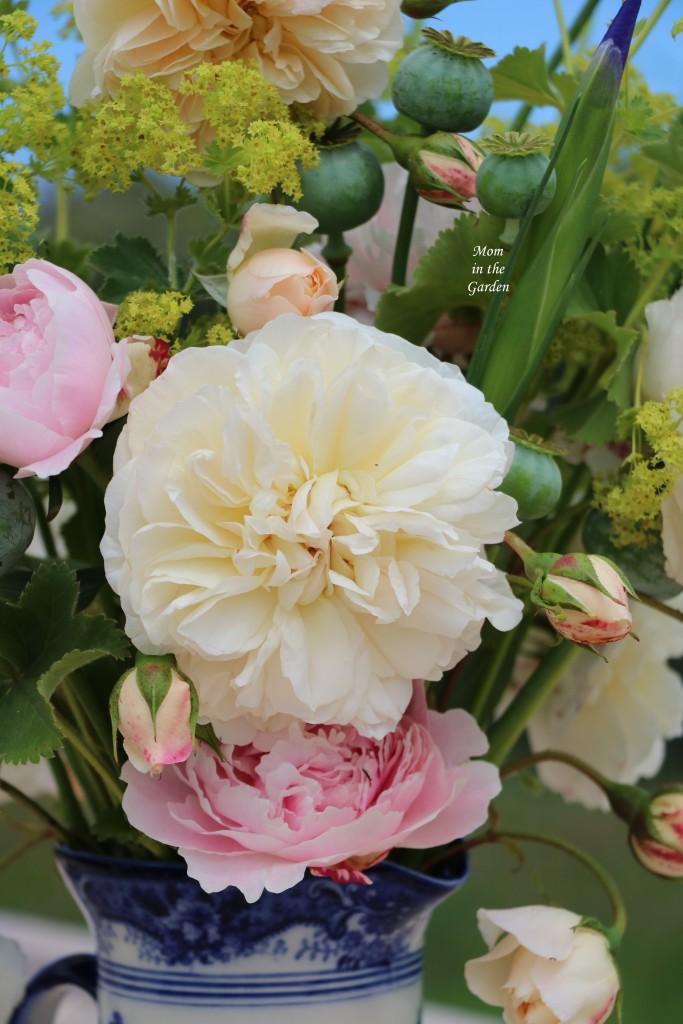 flower arrangement cream roses and peony